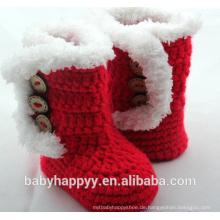 Baby-handgemachte Häkelarbeit stricken rote neugeborene Beuten-Schuhe