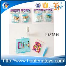 H187549 Gros perles d'eau en plastique en gros fabriqués différentes images jouets diy mis en place pour les enfants