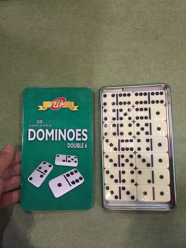 ivory plastic dominoes in tin box