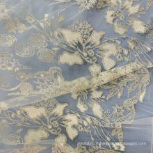 Tissu en maille blanche avec paillettes
