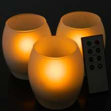 Radiant remoted LED tealight candle in glass