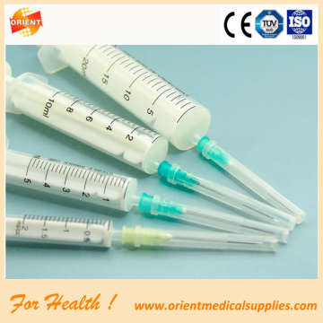 Plastic medical disposable syringe with needle