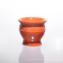 Suportes de vela de cerâmica laranja