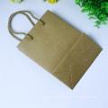 Saco de papel marrom artesanal simples para presentes