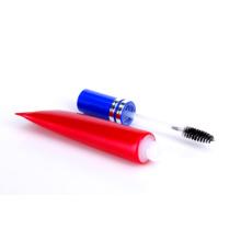 Tubo cosmético plástico con aplicador de cepillo