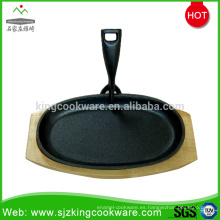Plato filete de hierro fundido redondo / Ovel con base de madera