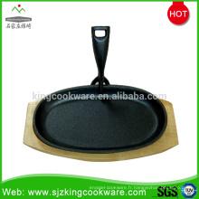 Assiette à steak en fonte ronde / ovale avec base en bois