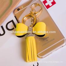 Jinhua novo estilo low moq bowknot borla personalizado couro keychain