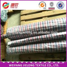 O fio 100% de algodão tingiu o tecido impresso do camisas o fio 100% de algodão tingiu o tecido tecido do lote do estoque shirting