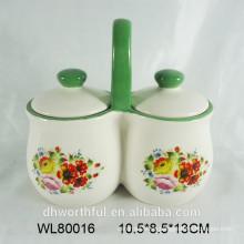 Tarro de condimentos cerámicos con flor