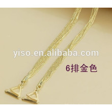 Tiras de sutiã de metal dourado