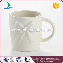 Vara Bow ceramic embossed mug for sale