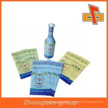 Étiquette imprimée personnalisée à base de thermorésistant en matière plastique plastique pour emballage de bouteilles