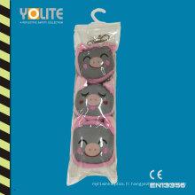 Cintre réfléchissant rose de porc avec des sacs de PVC