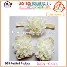 Caiga los zapatos de bebé al por mayor descalzos de la marca de fábrica conocida del envío