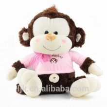 Mono juguete de peluche con tela