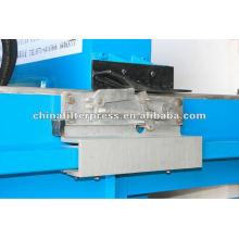 Proteger la palanca de cambio de la placa de prensa de filtro