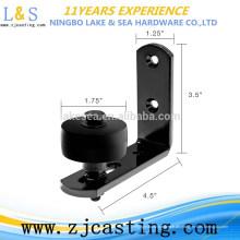 Schwarze an der Wand befestigte untere Boden-Führungs-Stollen-Rolle für Scheunen-Tür-Hardware