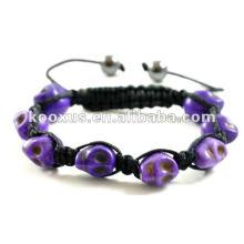 Фиолетовый браслет из 8 черепов shamballa