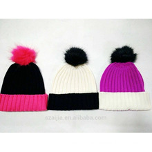 Ladies colorful knitted beanie with fake fur pom