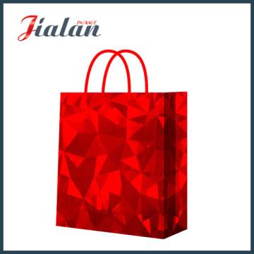 Film brillant rouge Bonne qualité Personnaliser le sac de vêtements en papier holographique