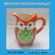 Handmade ceramic water jug with owl design