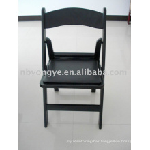 Black plastic resin folding chair