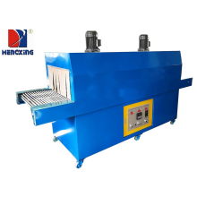 Plastic film shrink wrapping packing machine