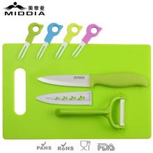 Fourchettes à fruits en céramique avec couteau et éplucheur et planche à découper