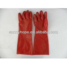 Gant en caoutchouc en PVC rouge finition lisse