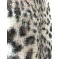 Casaco de pele falsa com estampa de leopardo
