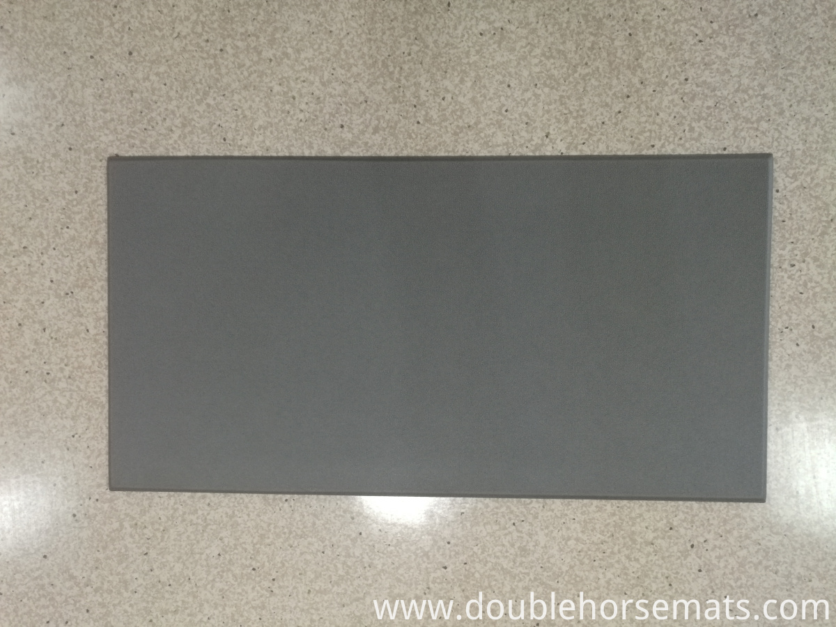 The textured single color floor mat