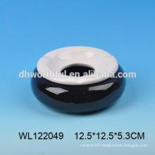 White and black ceramic ashtray