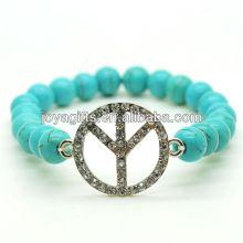 Türkis 8MM runde Perlen Stretch Edelstein Armband mit Diamante Peace Logo in der Mitte