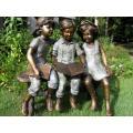 theme park statue metal craft bronze children on bench sculpture