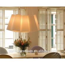 interior white fauxwood sliding plantation window shutters
