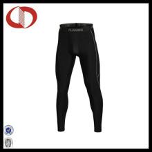 Pantalones deportivos de compresión al por mayor de los hombres que funcionan