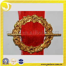 golden flower-shaped curtain buckle