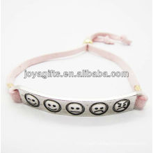silver alloy carved phiz symbol with pink leather bracelet