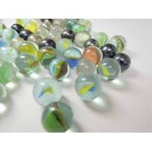 Three flower glass marbles for children playing