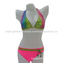 Triangle bikinis, two pieces with full print tie at top and match color belt and solid color pants