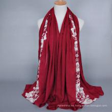 Venta al por mayor moda algodón musulmán Jersey Hijab de calidad superior patrón de flores bordado hijab chal