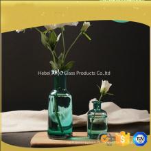 Vase en verre bleu large bouche pour décoration maison avec fleur
