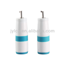 ceramic oil and vinegar bottle with silicone band and base