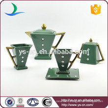 Good looking green ceramic gold plated coffee set