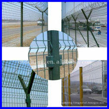 Airport security fence with Y post and barbed wire