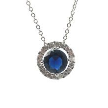 Pingente redondo em prata com círculo de pedra azul