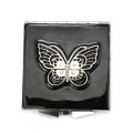 Espelhos compactos de borboleta preta