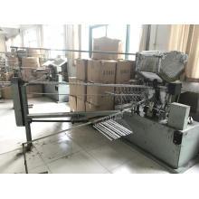 Máquina automática para fabricar revestimientos de tubos de puntal de papel