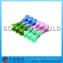 Moule en plastique de clip de tissu